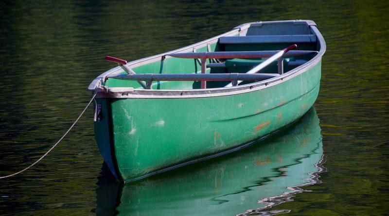 Green canoe on water